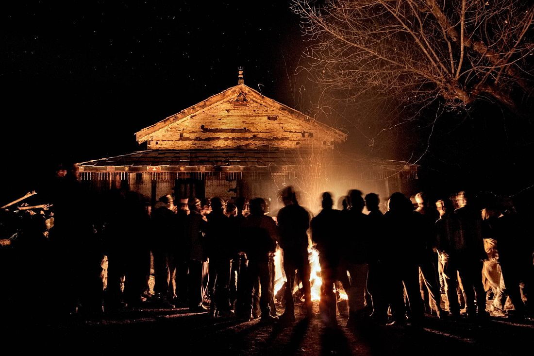 Villagers gather around a big fire set in front of the temple in occasion of the mela. Villagers are mainly Hindu, although they hail as well minor deities worshipped in the mountains, locally known as devta