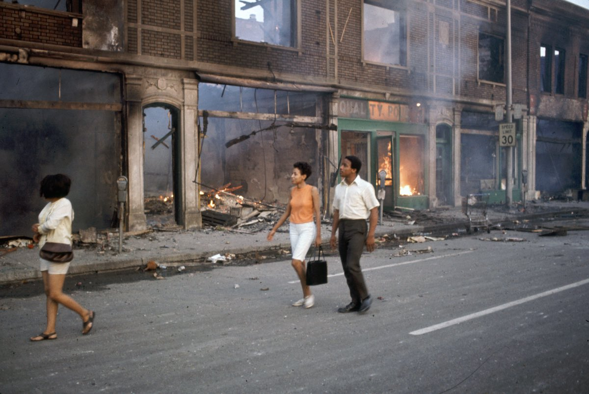 Subject: African Americans stroll the burning streets of Detroit during the race riots.  Detroit, Michigan 1967 Photographer- Howard Bingham Time inc NOT owned Merlin-1153219