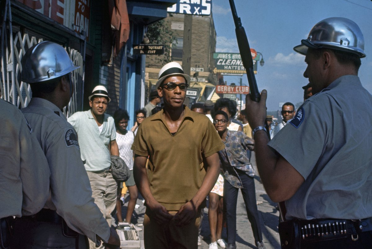 Subject: Detroit Police officers confronting African American people in the streets during the Race Riots, Detroit, Michigan July 1967 Photographer- Lee Balterman Time Inc Owned Merlin-1153177