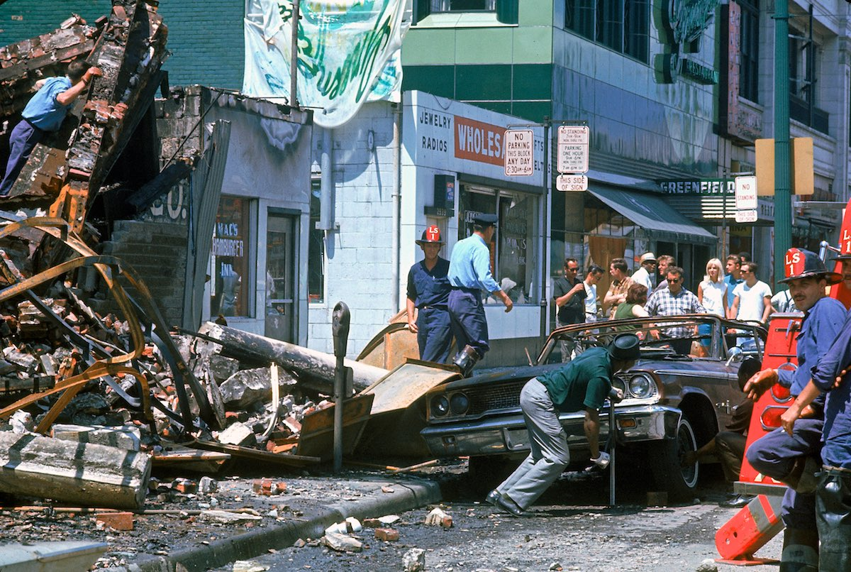 DETROIT, UNITED STATES - JULY 01:  Firemen and civilians starting to clear debris the morning after after race riots rock the city.  (Photo by Declan Haun/The LIFE Picture Collection/Getty Images)