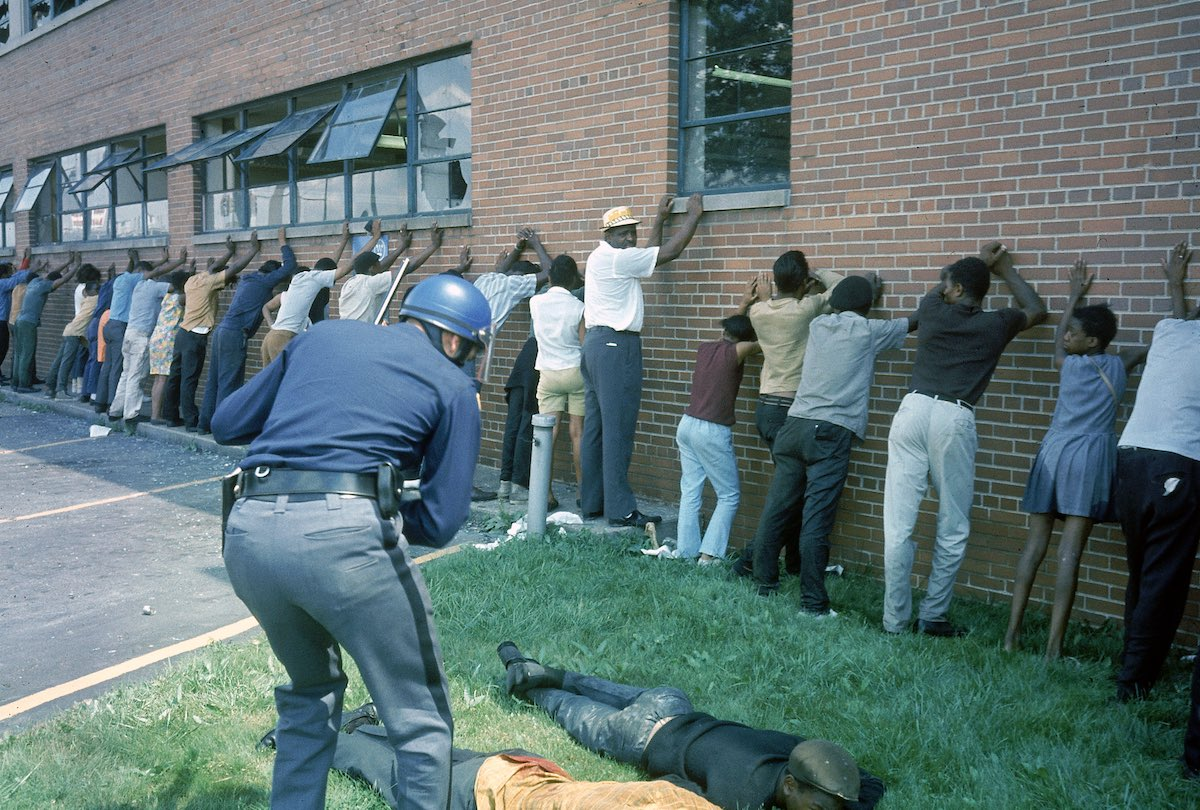 MICHIGAN, UNITED STATES - 1967:  Policeman lining up suspects after race riots.  (Photo by Declan Haun/The LIFE Picture Collection/Getty Images)