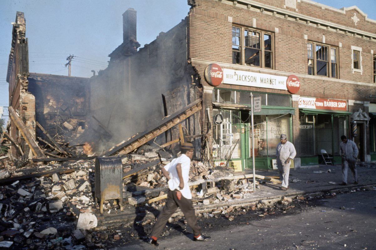 Subject: People walk by destroyed and burned out building caused by the Race Riots in Detroit, Michigan July 1967 Photographer- Lee Balterman Time Inc Owned Merlin-1153578