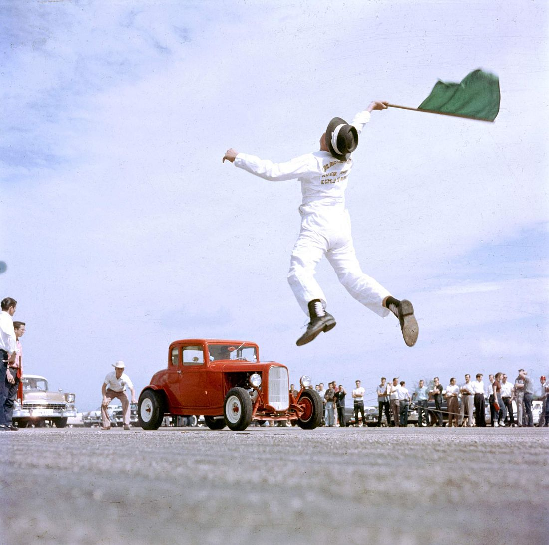 Subject: Starter flagging dragsters to start at Eagle Mt. Fort Worth, Texas 1957 Photographer- A.Y. Owen Time Inc NOT OWNED merlin- 1202950