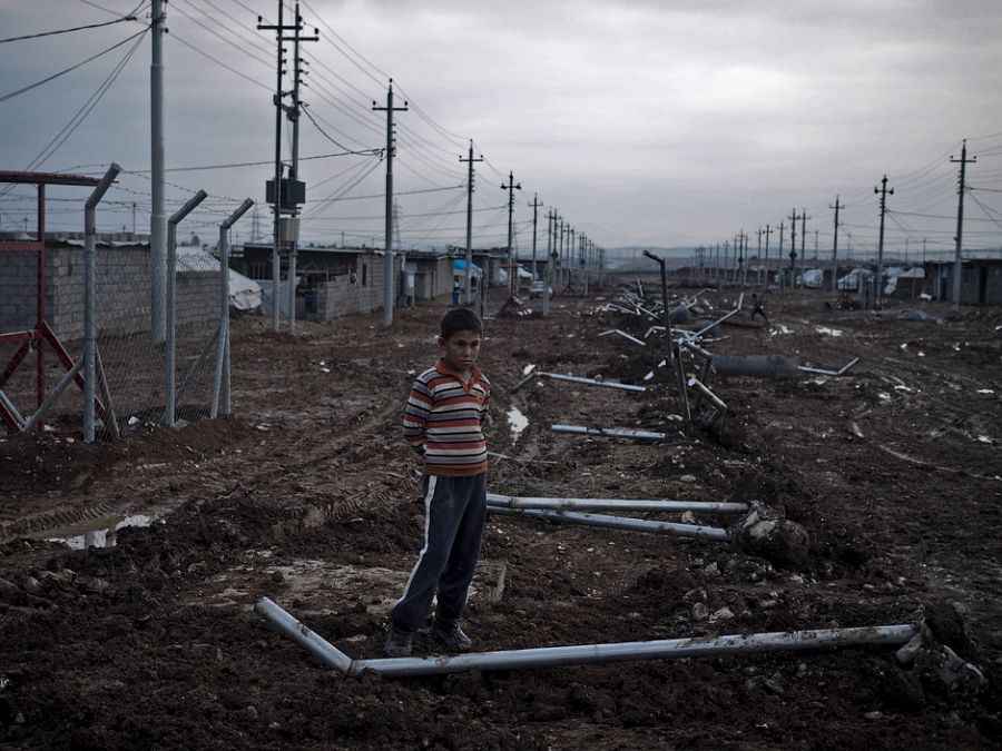 IRAQ. Kurdistan. December 4, 2014. 12-year-old Salah Sleman, a Kurdish boy from the Kurdish-Syrian town of Kobani, now lives at a camp i Arbad for displaced families on the outskirts of Suleimaniyah.