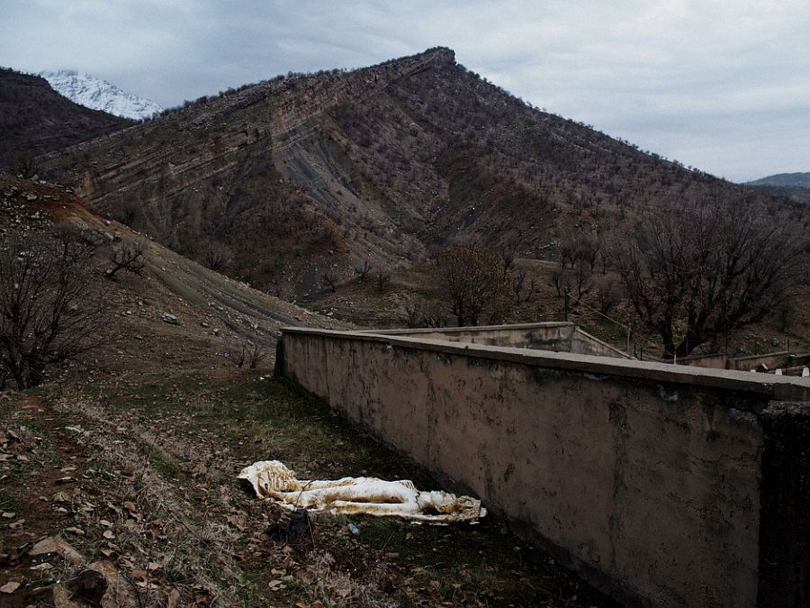 IRAQ. Kurdistan. December 1, 2014. A monument erected in honor of fallen PKK fighters overlooks the Qandil Mountains in Iraqi Kurdistan. In the 1990s, during some of the deadliest years of the PKK-Turkey conflict, the PKK set up bases across the rugged Qandil Mountains in Iraqi Kurdistan,near the border of Iran. Since then, Turkey has periodically carried out air strikes in Qandil, aiming to hit the thousands of fighters who train and live in the moutain. But the PKK fighters in Qandil operate in various pockets of the mountain, and often live in caves, making it near impossible for Turkish jets to precisely target them. On several occasions, Turkish jets accidentally hit Iraqi Kurdish villagers living in the area instead. This prompted tensions between the the regional Iraqi Kurdish government and Turkey. In recent years, Turkey and the PKK have embarked on a fragile peace process, which has spared Qandil some of the heavy shelling of earlier years. But events in Syria and Iraq this past summer, in particular Turkish sensitivities to the PKK's increasingly prominent role in fighting the Islamic State and PKK allegations that Turkey was at times conspiring with IS to bring about the fall of Kobani, have strained the peace process. If the process collapses, the relative calm in Qandil may break as well.