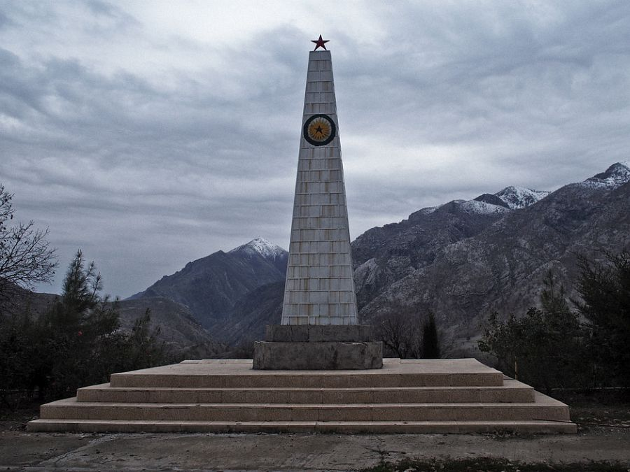 IRAQ. Kurdistan. December 1, 2014. A monument erected in honor of fallen PKK fighters overlooks the Qandil Mountains in Iraqi Kurdistan. In the 1990s, during some of the deadliest years of the PKK-Turkey conflict, the PKK set up bases across the rugged Qandil Mountains in Iraqi Kurdistan, near the border of Iran. Since then, Turkey has periodically carried out air strikes in Qandil, aiming to hit the thousands of fighters who train and live in the moutain. But the PKK fighters in Qandil operate in various pockets of the mountain, and often live in caves, making it near impossible for Turkish jets to precisely target them. On several occasions, Turkish jets accidentally hit Iraqi Kurdish villagers living in the area instead. This prompted tensions between the the regional Iraqi Kurdish government and Turkey. In recent years, Turkey and the PKK have embarked on a fragile peace process, which has spared Qandil some of the heavy shelling of earlier years. But events in Syria and Iraq this past summer, in particular Turkish sensitivities to the PKK's increasingly prominent role in fighting the Islamic State and PKK allegations that Turkey was at times conspiring with IS to bring about the fall of Kobani, have strained the peace process. If the process collapses, the relative calm in Qandil may break as well.