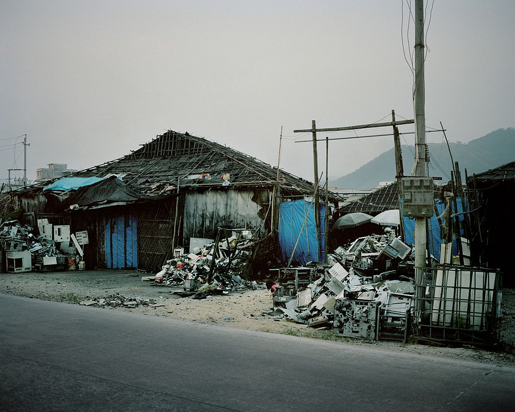 Guiyu, China On the outside of a workshop where are dismantled and recycled electrical and electronic components.