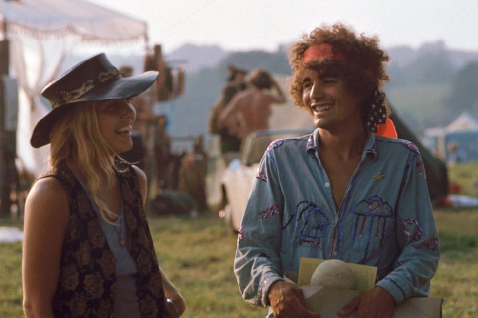 A pair of unidentified festival goers share a laugh during the Woodstock Music and Arts Fair, Bethel, New York, August 1969. The festival ran from August 15 to 18. (Photo by Ralph Ackerman/Getty Images)