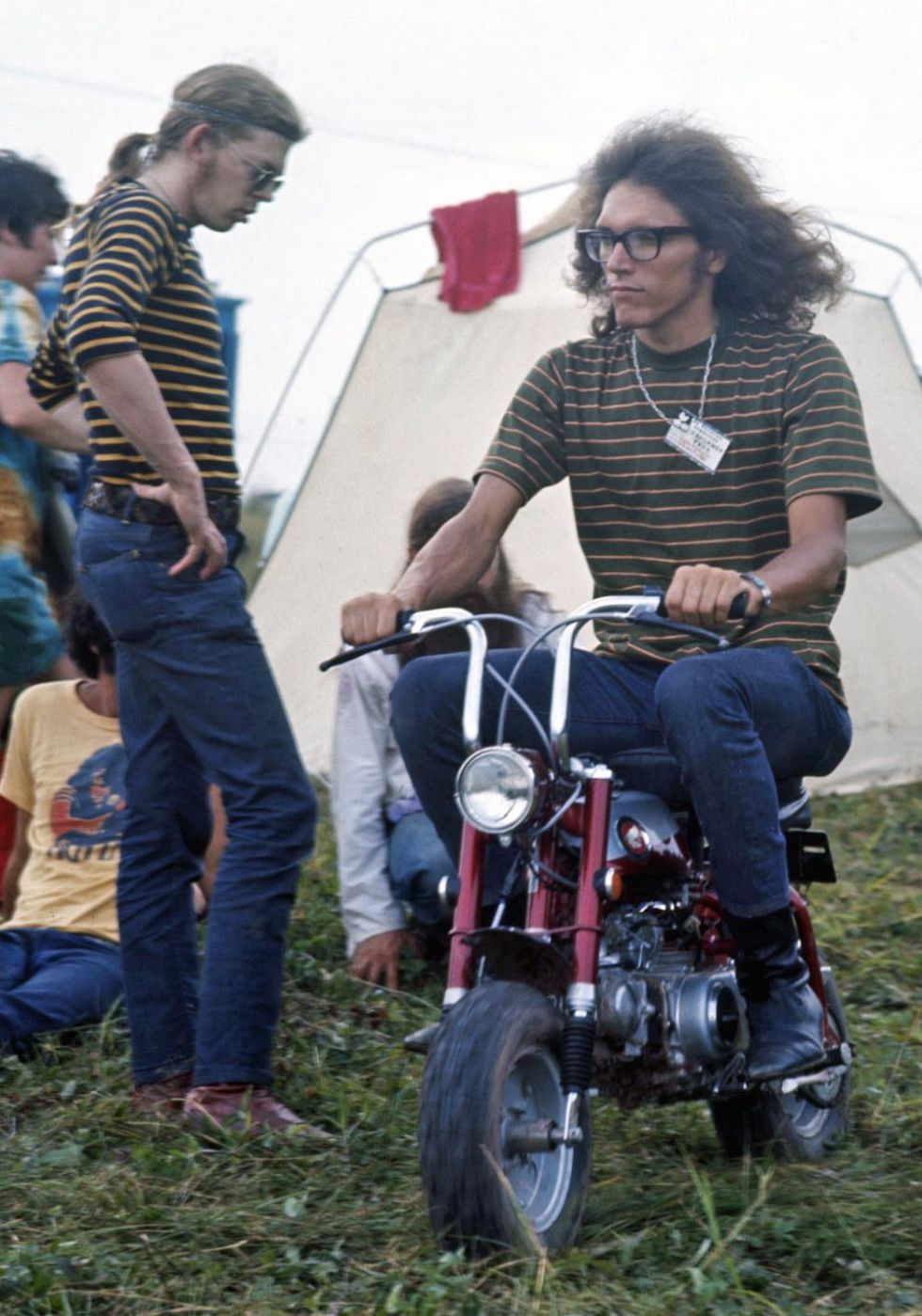 Member of band 'Jefferson Airplane' riding a motorcycle