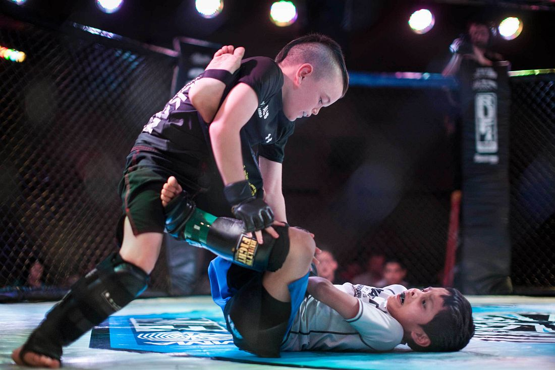 Mixed Martial Arts fighters Justin Ramirez, 7, and Chris Arrey, 7, fighting in the octagon in United States Fight League(USFL) All-star Pankration show at Blue Water Casino in Parker, Arizona on 25th of October 2013. Photo: Miikka Pirinen