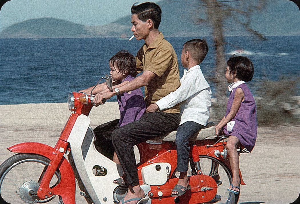 people-riding-motorcycles-on-the-streets-in-vietnam-in-1969-09
