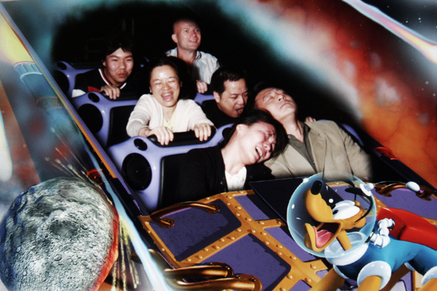 A souvenir photograph of tourist during an attraction at Disneyland in Hong Kong.